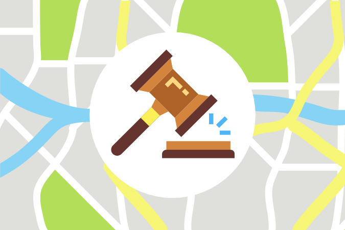graphic of city map with judge's gavel on top